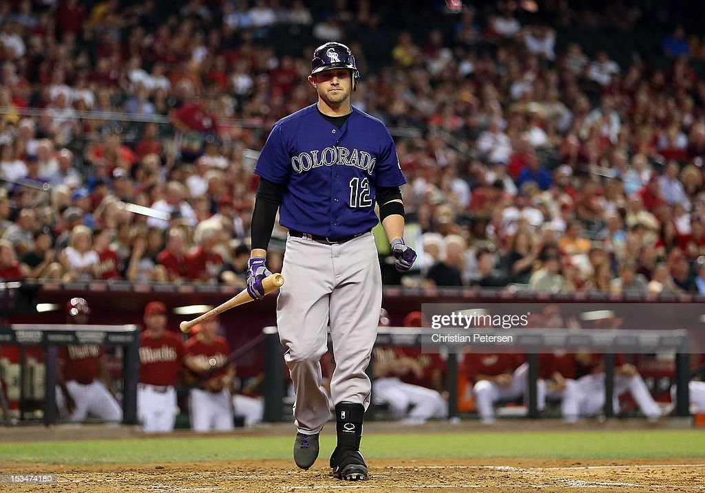 Andrew Brown #12 of the Colorado Rockies reacts after striking out against the Arizona Diamondbacks during the MLB game at Chase Field on October 3, 2012 in Phoenix, Arizona.