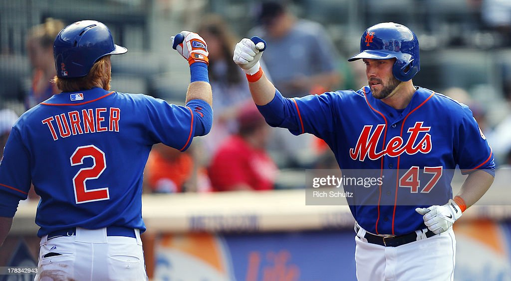 Andrew Brown #47 of the New York Mets is congratulated by <a gi-track='captionPersonalityLinkClicked' href=/galleries/search?phrase=Justin+Turner&family=editorial&specificpeople=550296 ng-click='$event.stopPropagation()'>Justin Turner</a> #2 after hitting a home run in the eighth inning against the Philadelphia Phillies on August 29, 2013 at Citi Field in the Flushing neighborhood of the Queens borough of New York City. The Mets defeated the Phillies 11-3.