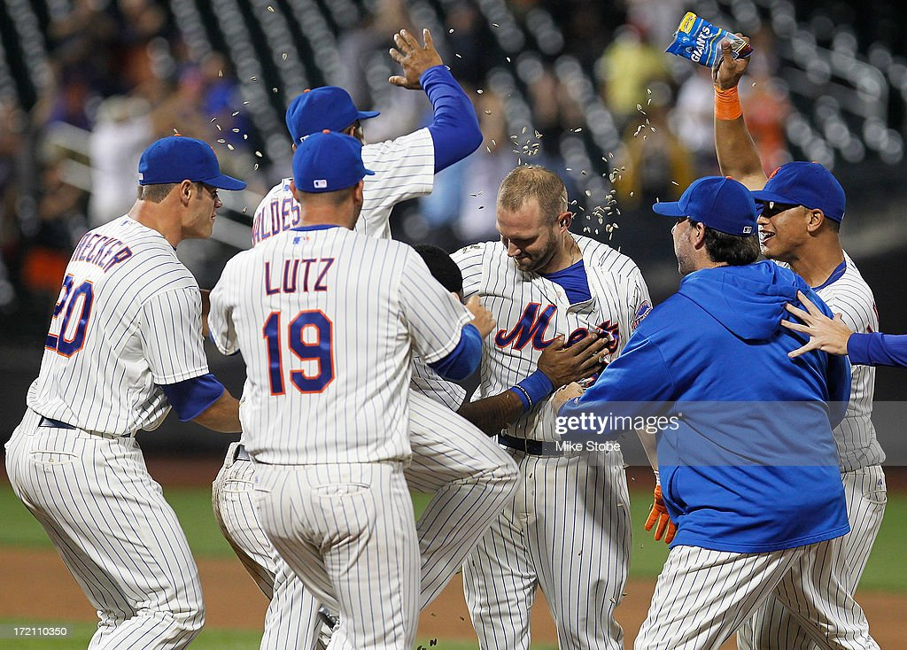 Andrew Brown #47 of the New York Mets is mobbed by his teammates after hitting a game winning two run single in the thirteenth inning against the Arizona Diamondbacks at Citi Field on July 1, 2013 at Citi Field in the Flushing neighborhood of the Queens borough of New York City. Mets defeated the Diamondbacks 5-4.