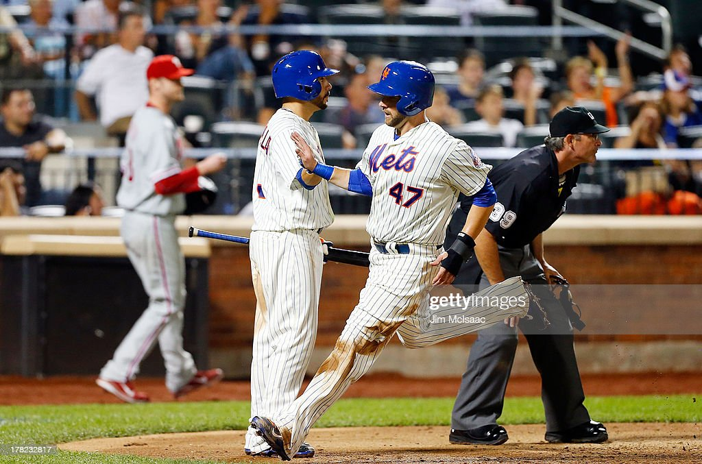 Andrew Brown #47 of the New York Mets scores a sixth inning run against the Philadelphia Phillies at Citi Field on August 27, 2013 in the Flushing neighborhood of the Queens borough of New York City.