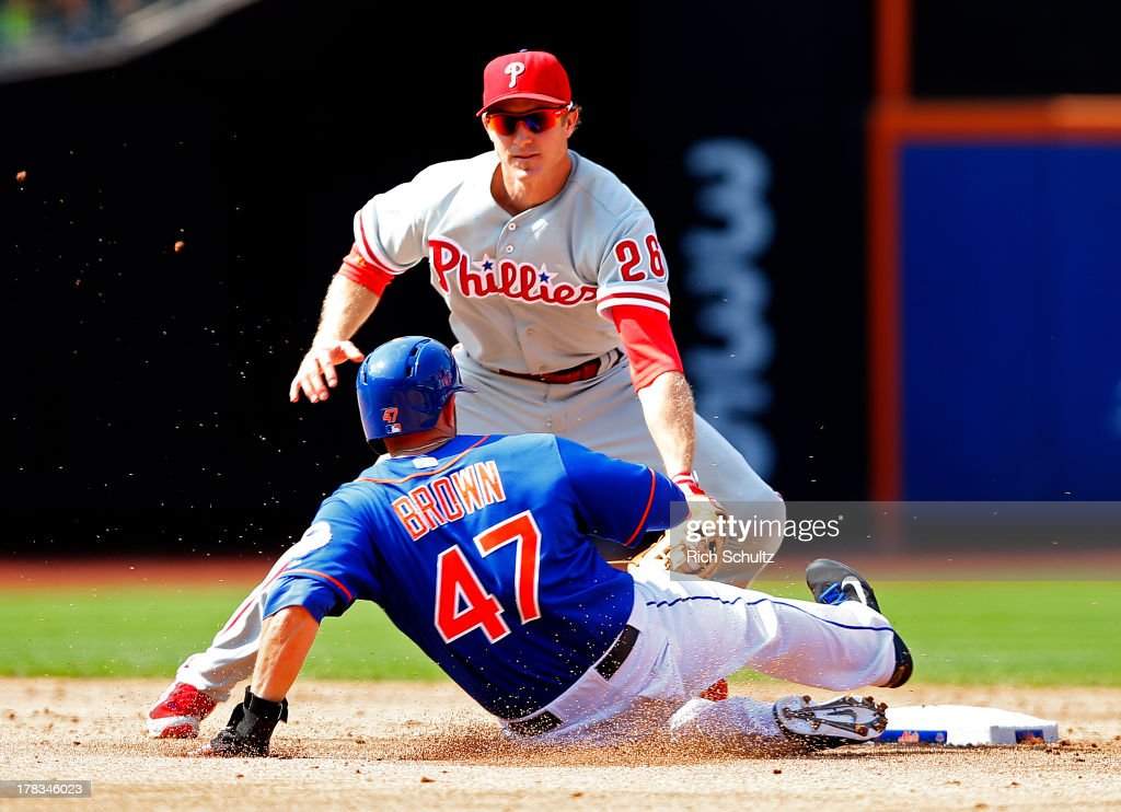 Andrew Brown #47 of the New York Mets steals second base before Chase Utley #26 ken apply the tag during the fifth inning on August 29, 2013 at Citi Field in the Flushing neighborhood of the Queens borough of New York City. The Mets defeated the Phillies 11-3.