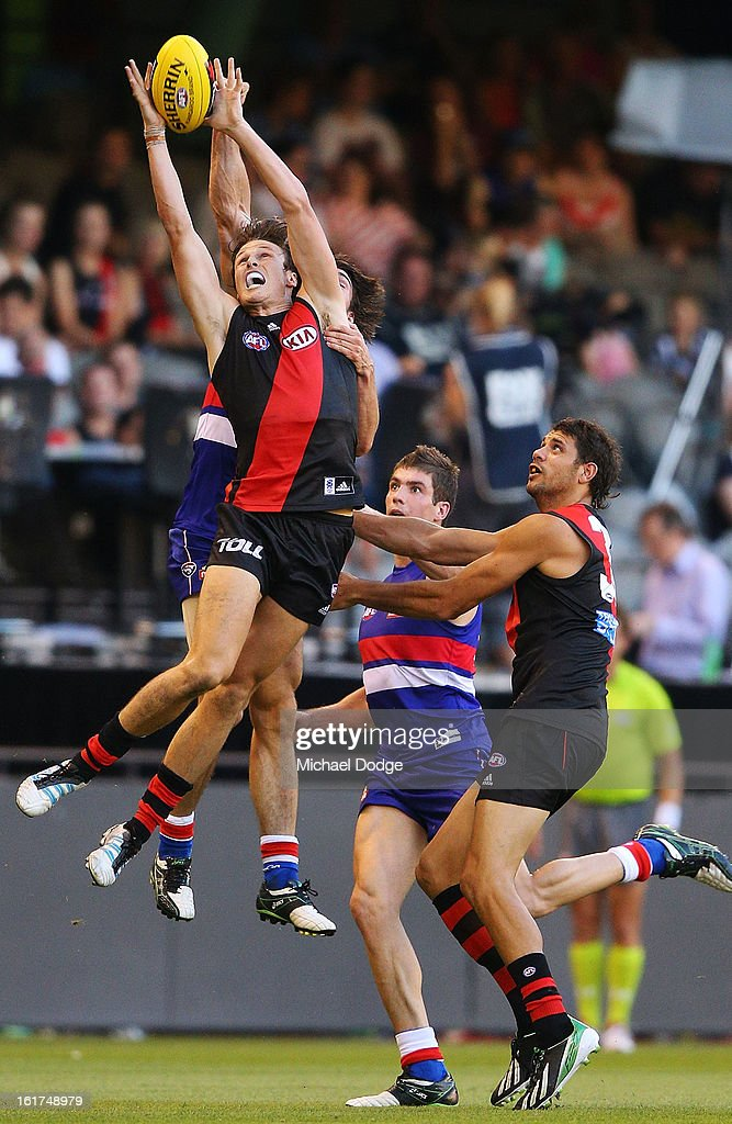 <a gi-track='captionPersonalityLinkClicked' href=/galleries/search?phrase=Andrew+Browne&family=editorial&specificpeople=176470 ng-click='$event.stopPropagation()'>Andrew Browne</a> of the Essendon Bombers marks the ball during the round one AFL NAB Cup match between the Essendon Bombers and the Western Bulldogs at Etihad Stadium on February 15, 2013 in Melbourne, Australia.