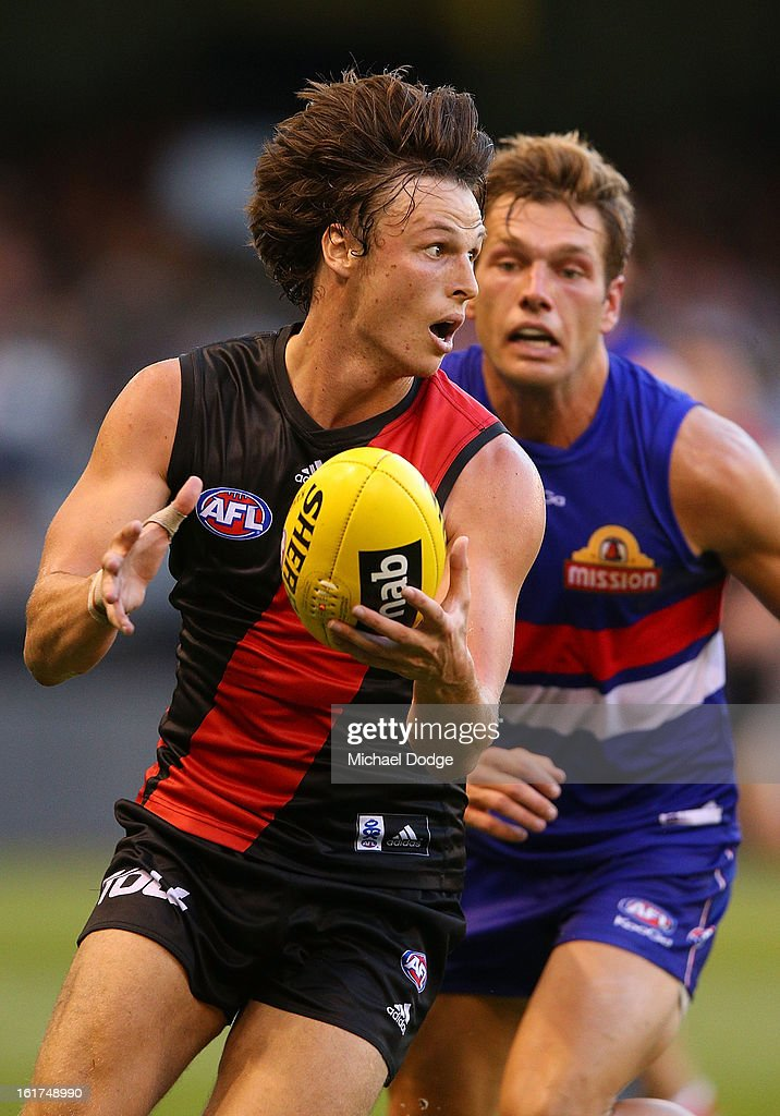 <a gi-track='captionPersonalityLinkClicked' href=/galleries/search?phrase=Andrew+Browne&family=editorial&specificpeople=176470 ng-click='$event.stopPropagation()'>Andrew Browne</a> of the Essendon Bombers runs with the ball during the round one AFL NAB Cup match between the Essendon Bombers and the Western Bulldogs at Etihad Stadium on February 15, 2013 in Melbourne, Australia.