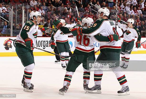 Andrew Brunette of the Minnesota Wild celebrates with teammates Antti Miettinen PierreMarc Bouchard Mikko Koivu and Marek Zidlicky after Brunette...