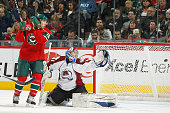 Andrew Brunette watches the shot of his Minnesota Wild teammate Antti Miettinen go past Craig Anderson of the Colorado Avalanche for a goal during...