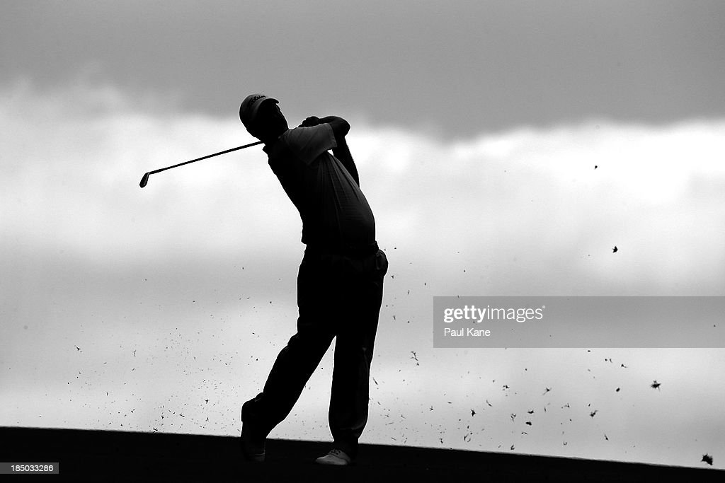<a gi-track='captionPersonalityLinkClicked' href=/galleries/search?phrase=Andrew+Buckle&family=editorial&specificpeople=678787 ng-click='$event.stopPropagation()'>Andrew Buckle</a> of Australia plays his approach shot on the 13th hole during day one of the Perth International at Lake Karrinyup Country Club on October 17, 2013 in Perth, Australia.