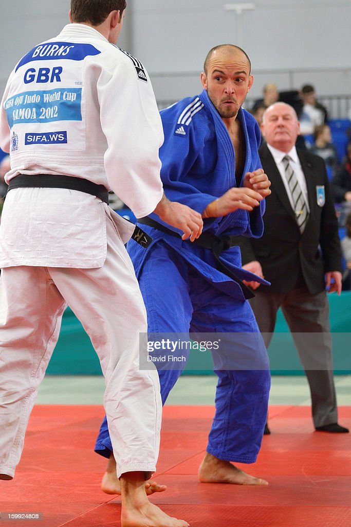 Andrew Burns of Team Bath (white) defeated Paralympic bronze and silver medallist, Sam Ingram of Edinburg Club getting ready to leap at Burns here, by ippon with a hold in their u90kgs pool contest during the British Senior Judo Championships on Sunday, January 20, 2013 at the English Institute of Sport, Sheffield, England, UK.