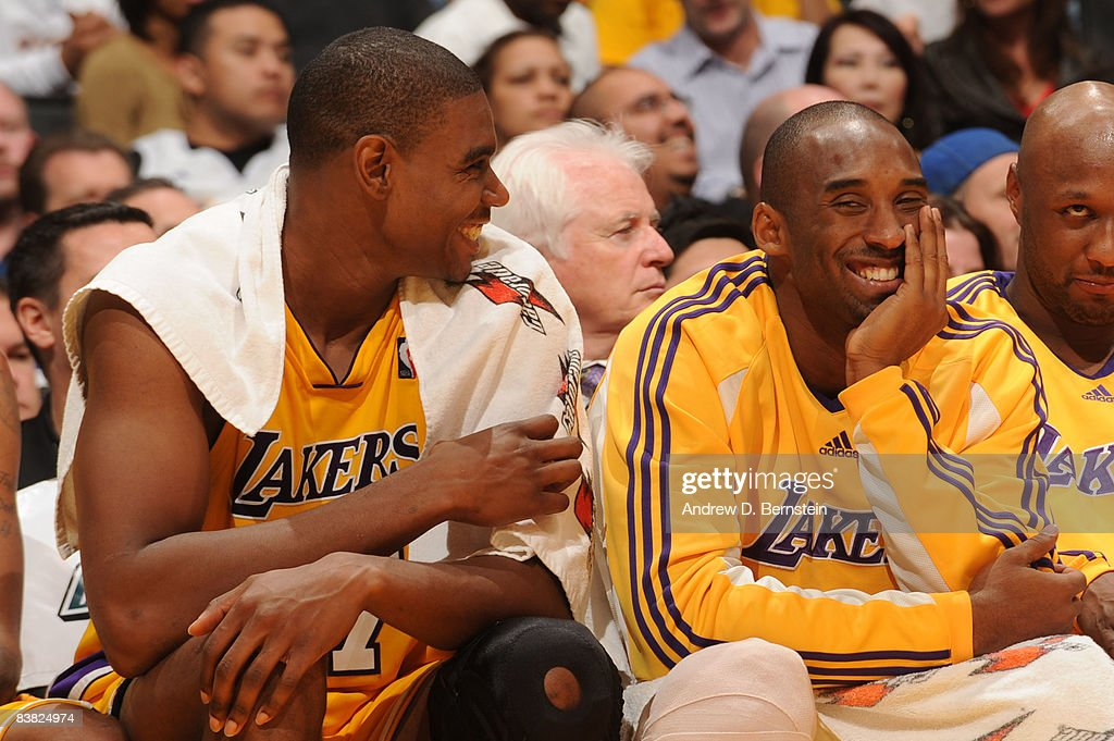 Andrew Bynum #17 and Kobe Bryant #24 of the Los Angeles Lakers smile from the bench during the game against the New Jersey Nets at Staples Center on November 25, 2008 in Los Angeles, California.