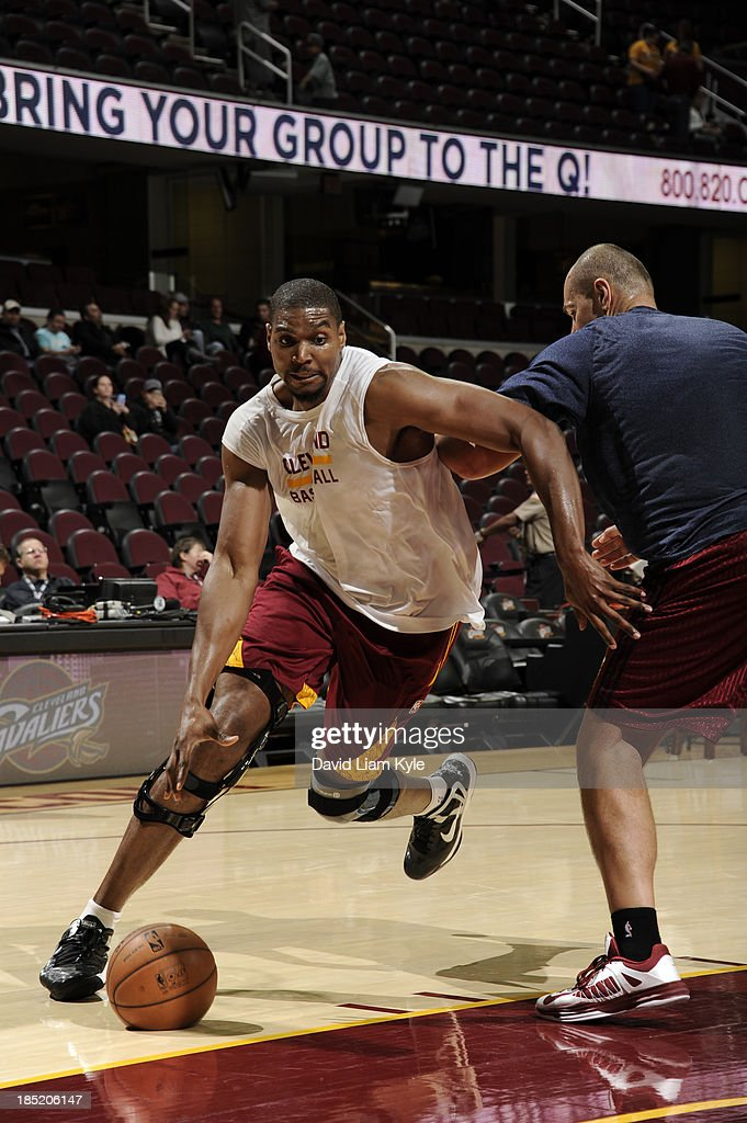 <a gi-track='captionPersonalityLinkClicked' href=/galleries/search?phrase=Andrew+Bynum&family=editorial&specificpeople=630695 ng-click='$event.stopPropagation()'>Andrew Bynum</a> #21 of the Cleveland Cavaliers drives to the basket against player development coach <a gi-track='captionPersonalityLinkClicked' href=/galleries/search?phrase=Vitaly+Potapenko&family=editorial&specificpeople=202075 ng-click='$event.stopPropagation()'>Vitaly Potapenko</a> prior to the game against the Detroit Pistons at The Quicken Loans Arena on October 17, 2013 in Cleveland, Ohio.