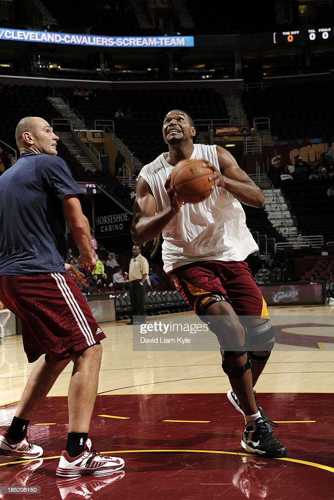 <a gi-track='captionPersonalityLinkClicked' href=/galleries/search?phrase=Andrew+Bynum&family=editorial&specificpeople=630695 ng-click='$event.stopPropagation()'>Andrew Bynum</a> #21 of the Cleveland Cavaliers drives to the hoop against player development coach <a gi-track='captionPersonalityLinkClicked' href=/galleries/search?phrase=Vitaly+Potapenko&family=editorial&specificpeople=202075 ng-click='$event.stopPropagation()'>Vitaly Potapenko</a> prior to the game against the Detroit Pistons at The Quicken Loans Arena on October 17, 2013 in Cleveland, Ohio.