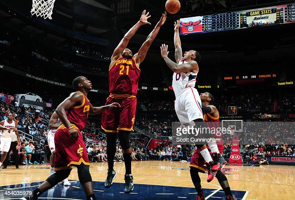 Andrew Bynum of the Cleveland Cavaliers goes up for a rebound Jeff Teague of the Atlanta Hawks on December 6 2013 at Philips Arena in Atlanta Georgia...