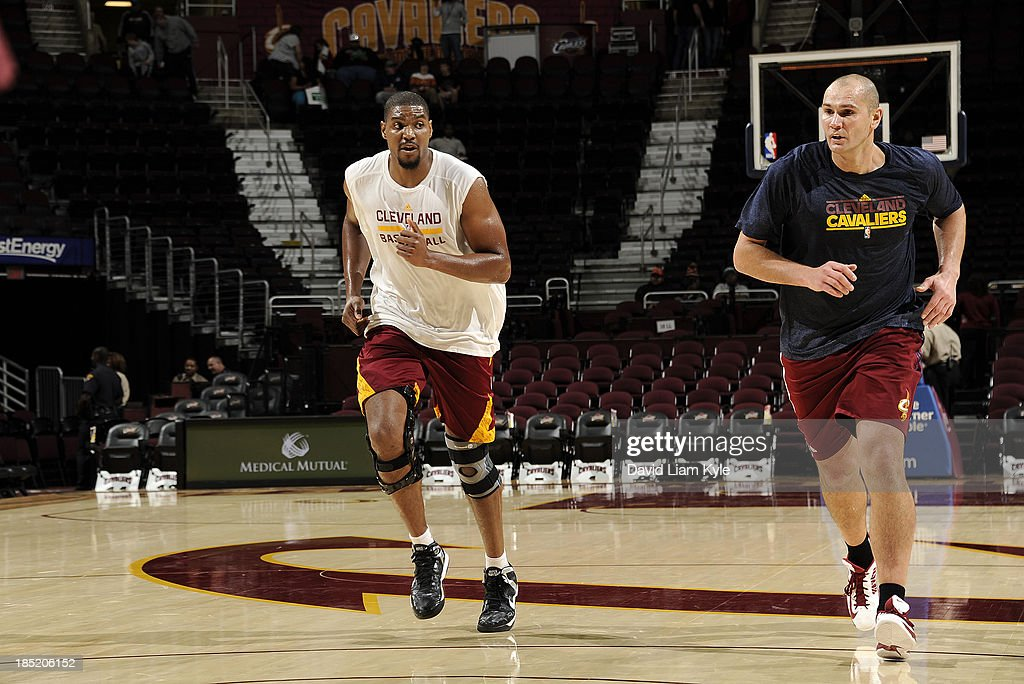 <a gi-track='captionPersonalityLinkClicked' href=/galleries/search?phrase=Andrew+Bynum&family=editorial&specificpeople=630695 ng-click='$event.stopPropagation()'>Andrew Bynum</a> #21 of the Cleveland Cavaliers runs up the court alongside player development coach <a gi-track='captionPersonalityLinkClicked' href=/galleries/search?phrase=Vitaly+Potapenko&family=editorial&specificpeople=202075 ng-click='$event.stopPropagation()'>Vitaly Potapenko</a> prior to the game against the Detroit Pistons at The Quicken Loans Arena on October 17, 2013 in Cleveland, Ohio.
