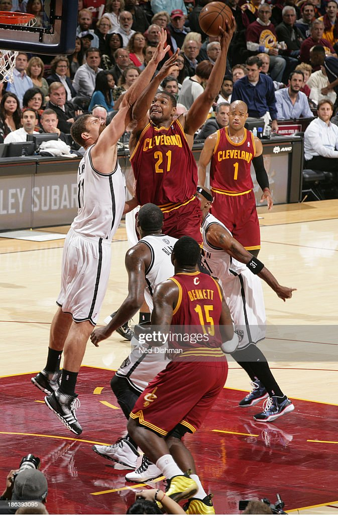 <a gi-track='captionPersonalityLinkClicked' href=/galleries/search?phrase=Andrew+Bynum&family=editorial&specificpeople=630695 ng-click='$event.stopPropagation()'>Andrew Bynum</a> #21 of the Cleveland Cavaliers shoots against <a gi-track='captionPersonalityLinkClicked' href=/galleries/search?phrase=Brook+Lopez&family=editorial&specificpeople=3847328 ng-click='$event.stopPropagation()'>Brook Lopez</a> #11 of the Brooklyn Nets during a game at the Quicken Loans Arena on October 30, 2013 in Cleveland, Ohio.