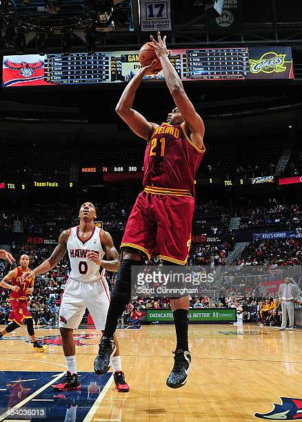 Andrew Bynum of the Cleveland Cavaliers shoots the ball against the Atlanta Hawks on December 6 2013 at Philips Arena in Atlanta Georgia NOTE TO USER...