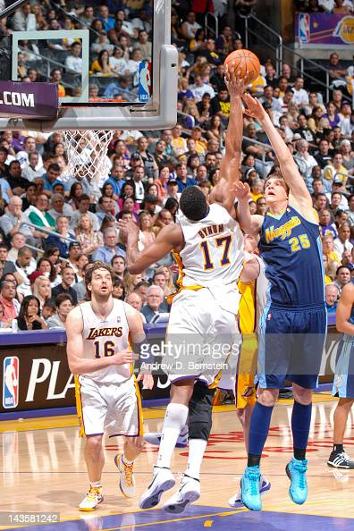 Andrew Bynum of the Los Angeles Lakers blocks a shot attempt by Timofey Mozgov of the Denver Nuggets in Game One of the Western Conference...