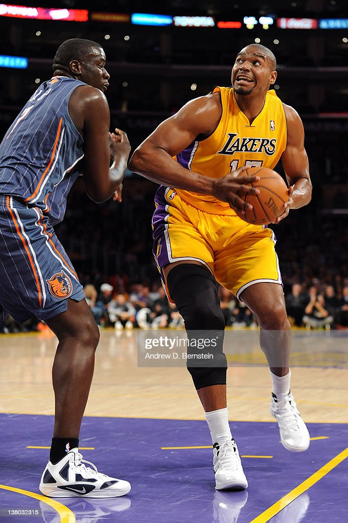 Andrew Bynum #17 of the Los Angeles Lakers drives the lane against DeSagana Diop #7 of the Charlotte Bobcats at Staples Center on January 31, 2012 in Los Angeles, California.