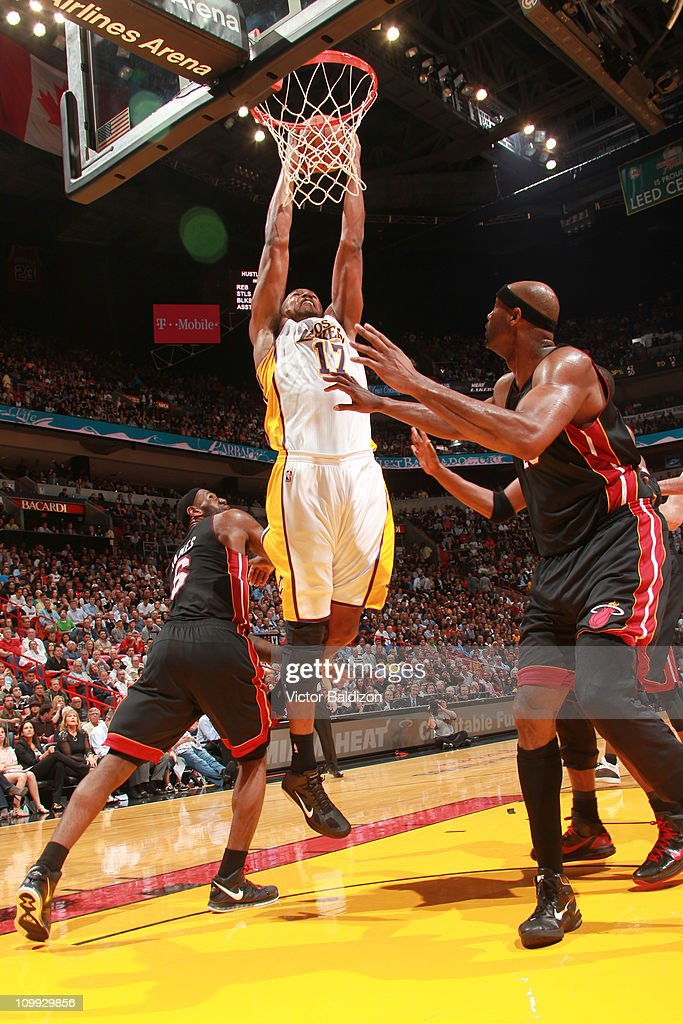 Andrew Bynum #17 of the Los Angeles Lakers dunks against Erick Dampier #25 of the Miami Heat on March 10, 2011 at American Airlines Arena in Miami, Florida.