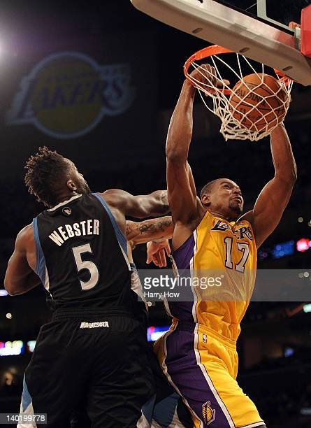 Andrew Bynum of the Los Angeles Lakers dunks in front of Martell Webster of the Minnesota Timberwolves at Staples Center on February 29 2012 in Los...