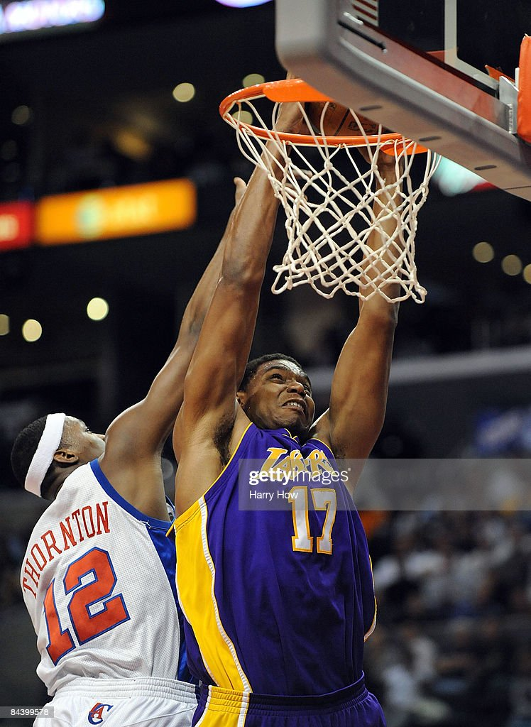 Andrew Bynum #17 of the Los Angeles Lakers dunks over Al Thornton #12 of the Los Angeles Clippers during the first half at the Staples Center January 21, 2009 in Los Angeles, California.