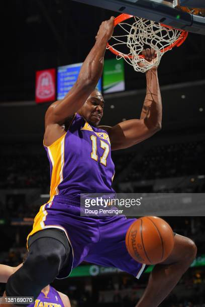 Andrew Bynum of the Los Angeles Lakers dunks the ball against the Denver Nuggets at the Pepsi Center on February 3 2012 in Denver Colorado NOTE TO...
