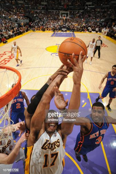 Andrew Bynum of the Los Angeles Lakers goes up for a shot against Shawne Williams of the New York Knicks at Staples Center on January 9 2011 in Los...