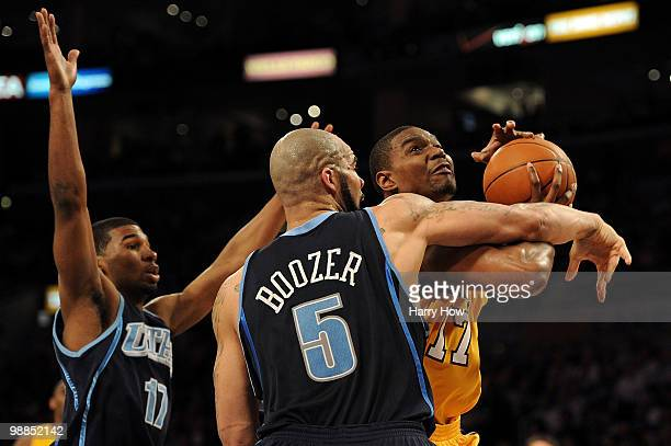 Andrew Bynum of the Los Angeles Lakers goes up for a shot against Carlos Boozer and Ronnie Price of the Utah Jazz in the first half during Game Two...