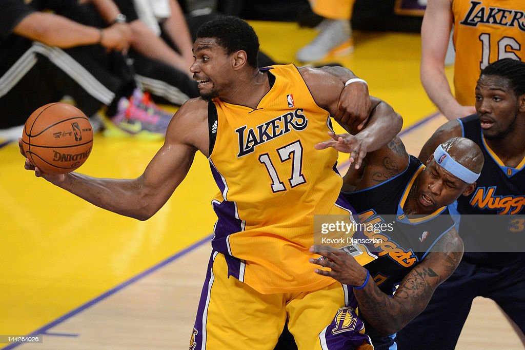 Andrew Bynum of the Los Angeles Lakers grabs the ball as he is tangled with Al Harrington of the Denver Nuggets in the second quarter in Game Seven...