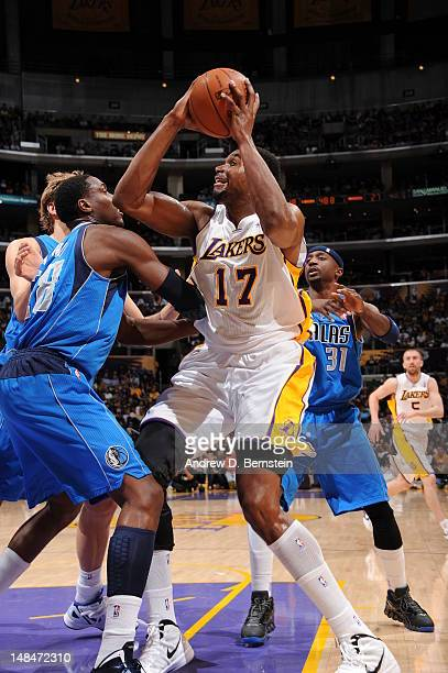 Andrew Bynum of the Los Angeles Lakers handles the ball against the Dallas Mavericks on April 15 2012 in Los Angeles California NOTE TO USER User...