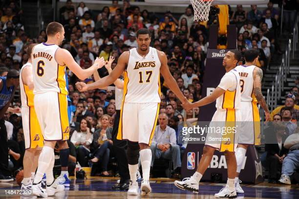 Andrew Bynum of the Los Angeles Lakers high fives his teammates during the game against the Dallas Mavericks on April 15 2012 in Los Angeles...
