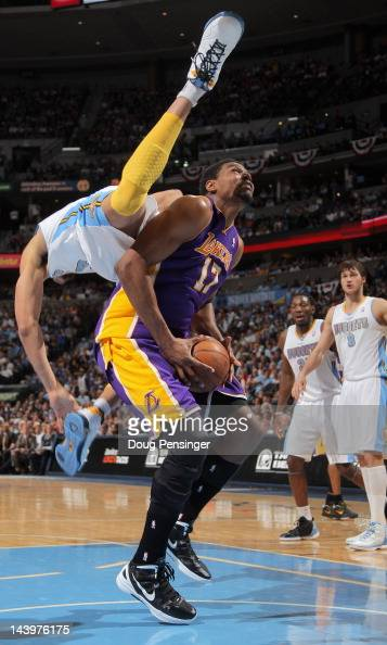 Andrew Bynum of the Los Angeles Lakers is fouled by JaVale McGee of the Denver Nuggets as he flips over him when attempting to block a shot in Game...