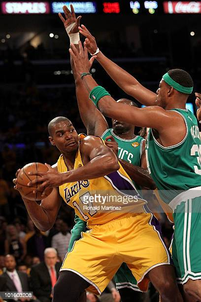 Andrew Bynum of the Los Angeles Lakers looks to pass around Paul Pierce and Kendrick Perkins of the Boston Celtics in Game One of the 2010 NBA Finals...