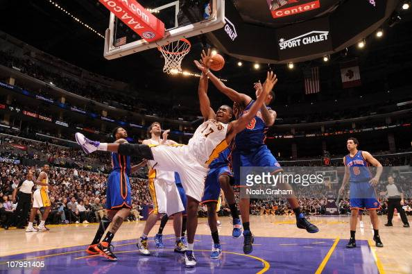 Andrew Bynum of the Los Angeles Lakers loses his balance during a game against the New York Knicks at Staples Center on January 9 2011 in Los Angeles...