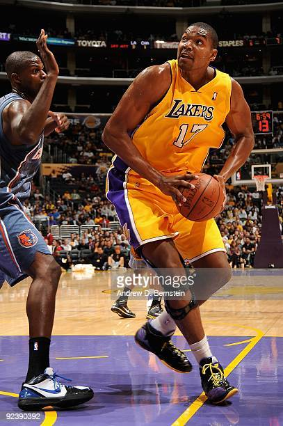 Andrew Bynum of the Los Angeles Lakers moves around Nazr Mohammed of the Charlotte Bobcats during the preseason game on October 17 2009 at Staples...