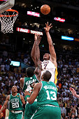 Andrew Bynum of the Los Angeles Lakers puts a shot up over Kendrick Perkins and Shelden Williams of the Boston Celtics in Game Two of the 2010 NBA...
