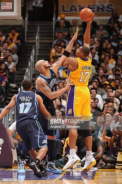 Andrew Bynum of the Los Angeles Lakers puts up a shot against Carlos Boozer of the Utah Jazz in Game Two of the Western Conference Semifinals during...