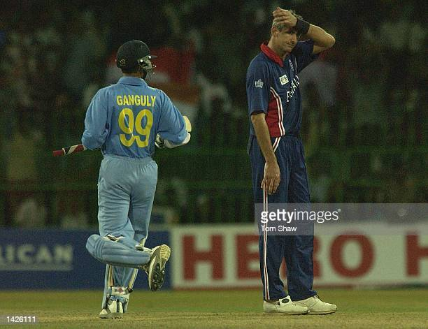 Andrew Caddick of England looks on dejected as Sourav Ganguly of India piles on the runs during the England v India match of the ICC Champions Trophy...