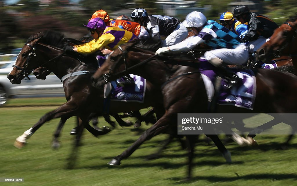 Andrew Calder riding Addictive Habit leads the start during The Sound Championship Stakes at Ellerslie Racecourse on January 1, 2013 in Auckland, New Zealand.