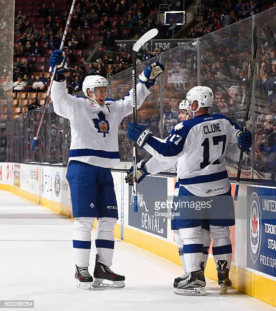 Andrew Campbell and Richard Clune of the Toronto Marlies celebrate a goal against the Manitoba Moose during AHL game action on December 6 2015 at the...