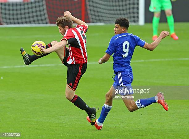 Andrew Cartwright of Sunderland clears ahead of Dominic Solanke of Chelsea during the Barclays U21 Premier League match between Sunderland and...