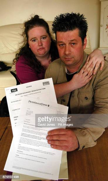 Andrew Cartwright with his wife Gemma holding his redundancy notice He has been an MG Rover employee in the paintshop for 18 yrs MG Rover workers...