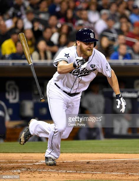 Andrew Cashner of the San Diego Padres hits a sacrifice bunt during the sixth inning of a baseball game against the Seattle Mariners at Petco Park...