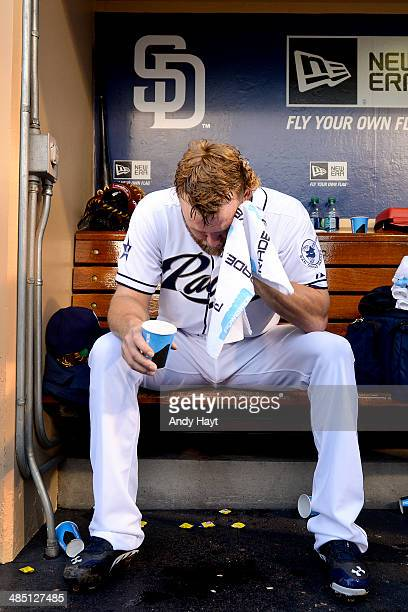 Andrew Cashner of the San Diego Padres towels off in the dugout prior to the game against the Detroit Tigers at Petco Park on April 11 2014 in San...