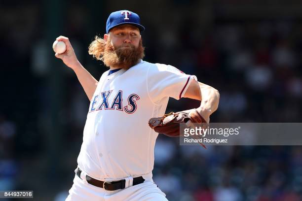 Andrew Cashner of the Texas Rangers delivers a pitch in the first inning of a game against the New York Yankees at Globe Life Park in Arlington on...