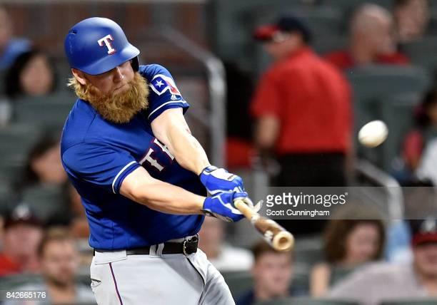 Andrew Cashner of the Texas Rangers hits a second inning sacrifice fly against the Atlanta Braves at SunTrust Park on September 4 2017 in Atlanta...