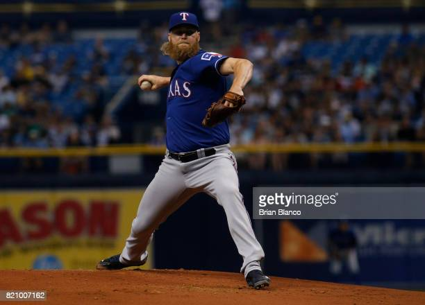 Andrew Cashner of the Texas Rangers pitches during the first inning of a game against the Tampa Bay Rays on July 22 2017 at Tropicana Field in St...