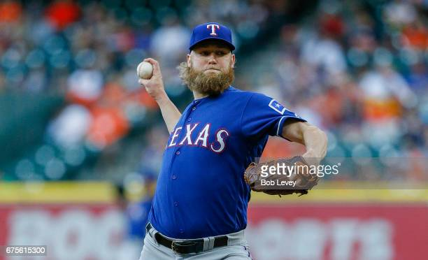 Andrew Cashner of the Texas Rangers pitches in the first inning Houston Astros at Minute Maid Park on May 1 2017 in Houston Texas