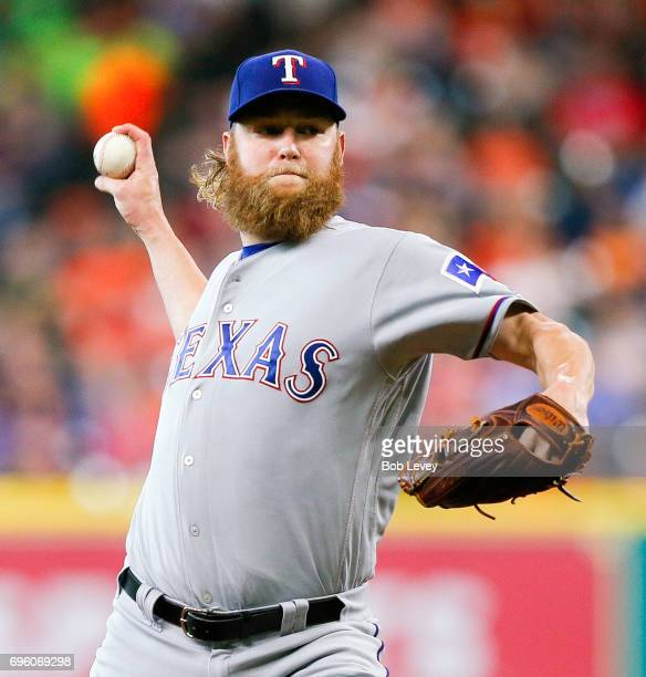 Andrew Cashner of the Texas Rangers pitches in the first inning against the Houston Astros at Minute Maid Park on June 14 2017 in Houston Texas
