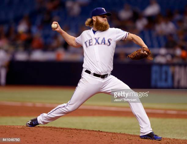 Andrew Cashner of the Texas Rangers throws a pitch during the fifth inning against the Houston Astros at Tropicana Field on August 30 2017 in St...