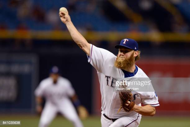 Andrew Cashner of the Texas Rangers throws a pitch during the first inning against the Houston Astros at Tropicana Field on August 30 2017 in St...