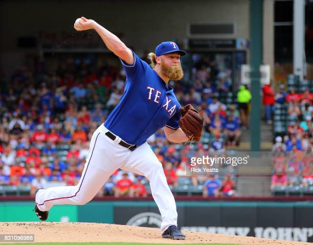 Andrew Cashner of the Texas Rangers throws in the first inning against the Houston Astros at Globe Life Park in Arlington on August 13 2017 in...